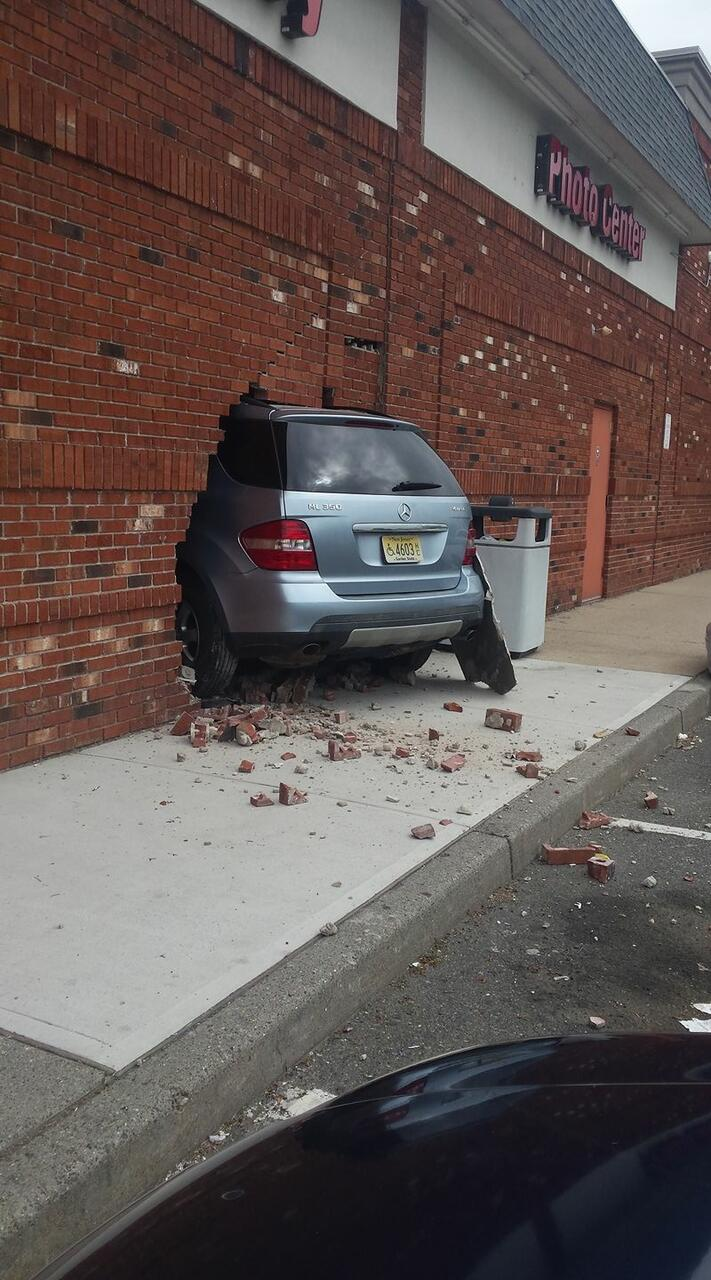 woman injured after crashing car into cvs pharmacy in