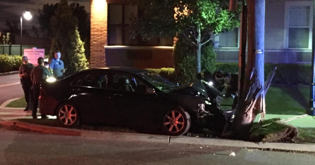 Photos: Car Crashes Into Telephone Pole, Driver Taken to